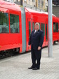 Seattle Mayor Greg nickels in front of the Inekon streetcar.