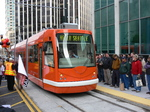 Inekon streetcar and Grand Opening Day crowd at Westlake Hub