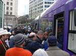 Seattle streetcar Grand Opening Day and crowd getting on.