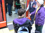 Seattle streetcar - wheelchair passenger is getting on.